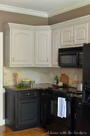 Painted Kitchen Cabinets by Black Appliances And White Or Gray Cabinets U2013 How To Make It Work
