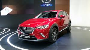 the new mazda the new mazda cx3 and 2 sedan at the 2016 singapore motorshow