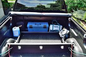 a wood pickup truck bed divider to keep your stuff from sliding around fits into