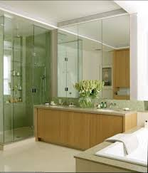 modern bathroom with wooden vanity cabinet white tub and green