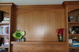 hand crafted built in bookcases fireplace surround by