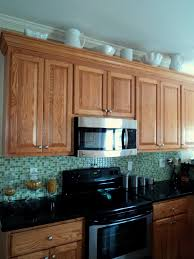 kitchen decorating above kitchen cabinets by arranging plates