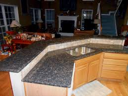 small white cabinets matching granite countertops with oak