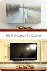 big screen tv cabinets diy flat screen hidden behind two painted canvases box wall design