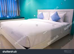 white blue pillows on bed comfortable stock photo 533770798