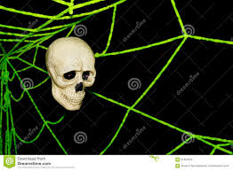 skull and spider webs on wall ghost on halloween stock photo