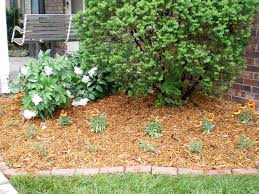 How To Mulch Flower Beds How To Keep Weeds And Grass Away From Flower Beds All Around