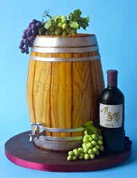 wine barrel cake with chocolate grapes and wine bottle for all