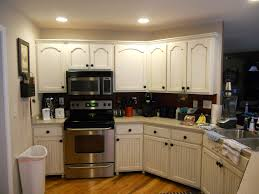 Antique White Cabinets With White Appliances by Antique White Cabinets With Brown Glaze Vintage Chic Painting