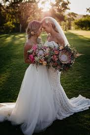 everything wedding beauty in this australian wedding with protea bouquets