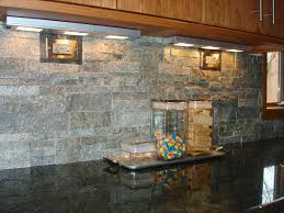 a stacked stone backsplash is a nice contrast with granite counter