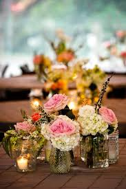 small centerpieces small vases with floral groupings simple but beautiful centerpiece