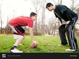 two boys playing football in the backyard stock photo offset
