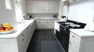 decorative kitchen tile flooring with white cabinets dark grey