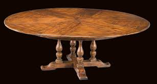 round dining room tables with self storing leaves 64 84 round solid walnut dining jupe table with hidden leaves