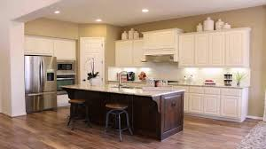 brown and white kitchen cabinets white kitchen cabinets with a brown island