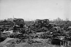 how did cleanup in nagasaki and hiroshima proceed following the