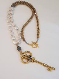 long necklace of cultivated pearls gilded crystals and