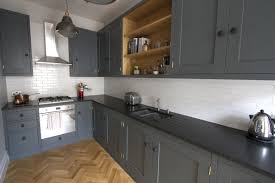 gray cabinets with black countertops black granite countertops a daring touch of sophistication to black