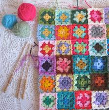 crocheting together the granny square patches and entertaining