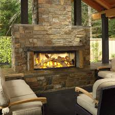 outdoor gas fireplace natural stone mantel lava rocks black iron