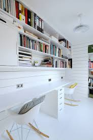 scandinavian home design ideas with white walls bookshelves and a