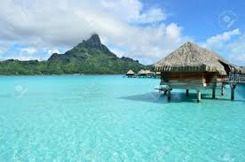 luxury overwater bungalow in a vacation resort in the clear blue