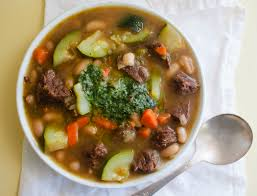 summer beef soup with vegetables and garden herb pesto