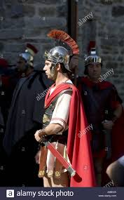 actor dressed in uniform of roman soldier during holy week passion