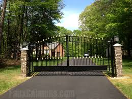 faux stone columns and a wrought iron gate create an impressive