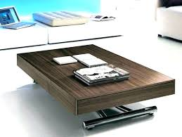 table converts to shelf shelf turns into table coffee table that turns into dining table
