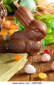 easter bunny candy chocolate easter bunny in a basket with assorted candy stock photo