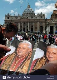 pope souvenirs dpa a seller of souvenirs sells pictures of pope benedict xvi