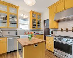 light yellow kitchen with white cabinets 24 yellow kitchen cabinet ideas sebring design build