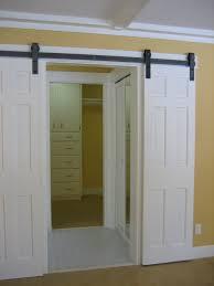 Wood Sliding Closet Door High White Wooden Sliding Closet Doors With Black Steel Handler On