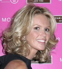elle macpherson semi short or medium length hairstyle with curls