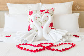 for honeymoon towel swans and flower on bedroom for honeymoon