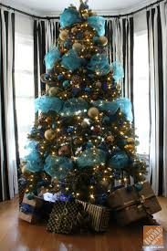tree decorations with blue ribbons happy holidays
