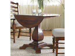 dining room rounded brown varnished oak wood dining table with