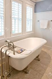 simple bathroom with clawfoot tub stock photo picture and royalty