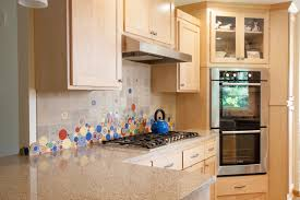 unique kitchen backsplash by mercury mosaics with bubbles and
