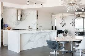 white marble kitchen island modern kitchen marble countertops and white cabinetry in a bright in