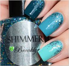the polished perfectionist blue green ombre nails with shimmer