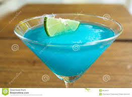 martini hawaiian frozen blue margarita cocktail in martini glass stock image