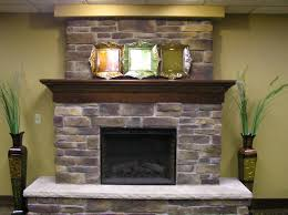 homey wooden living room with appealing stone fireplace mantels