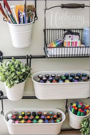 store art supplies in hanging buckets from ikea for easy craft