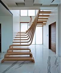 homedesigning via 25 unique staircase designs to take center
