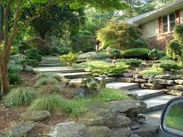 front of house landscaping with natural stone staircase in upper