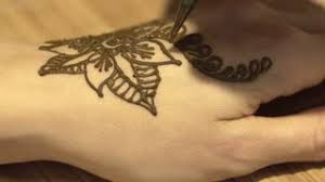 close up shot of female hand with henna tattoo pretty