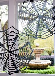 diy trash bag spiderwebs cheap u0026 easy halloween decor